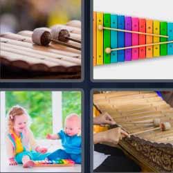 4 fotos 1 palabra marimba bebés jugando